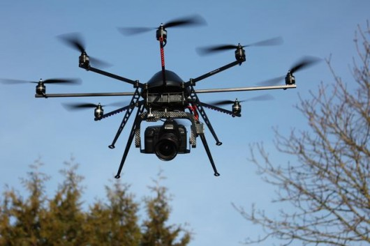 Octocopter with big video camera - Source