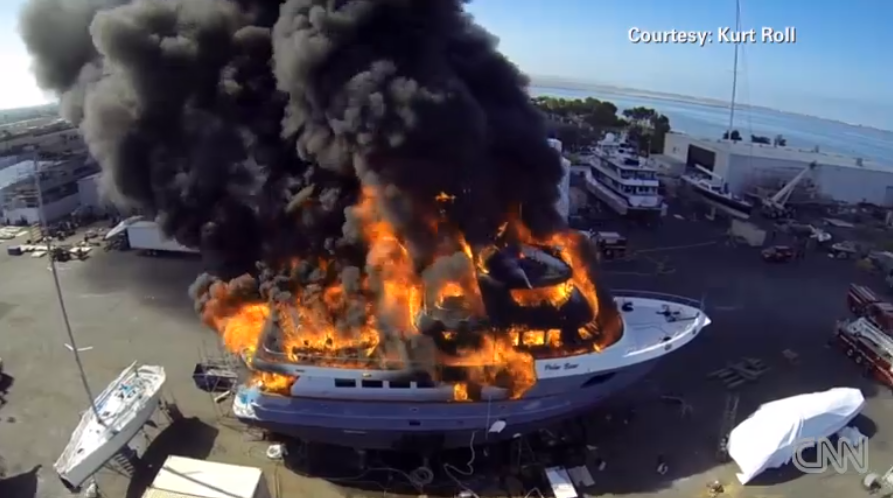 A yacht in fire captured by quadcopter