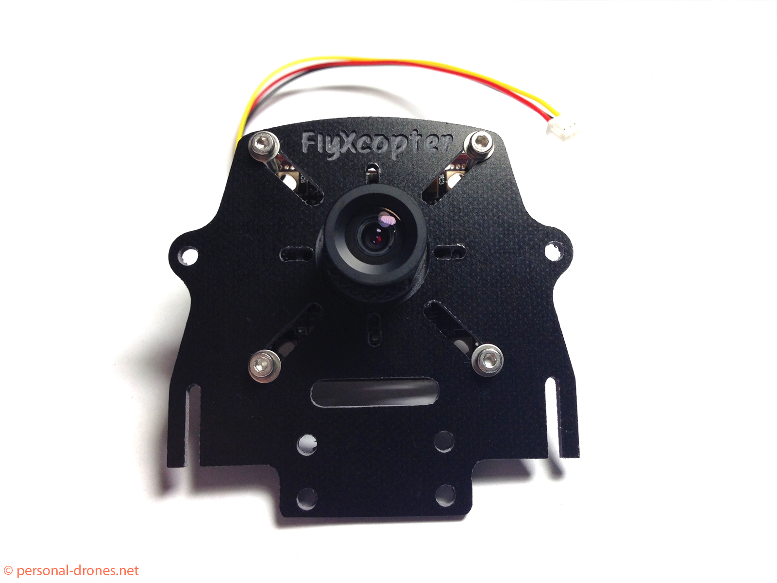 "FlyXcopter front camera mount with a ""standard"" CCD camera in place"