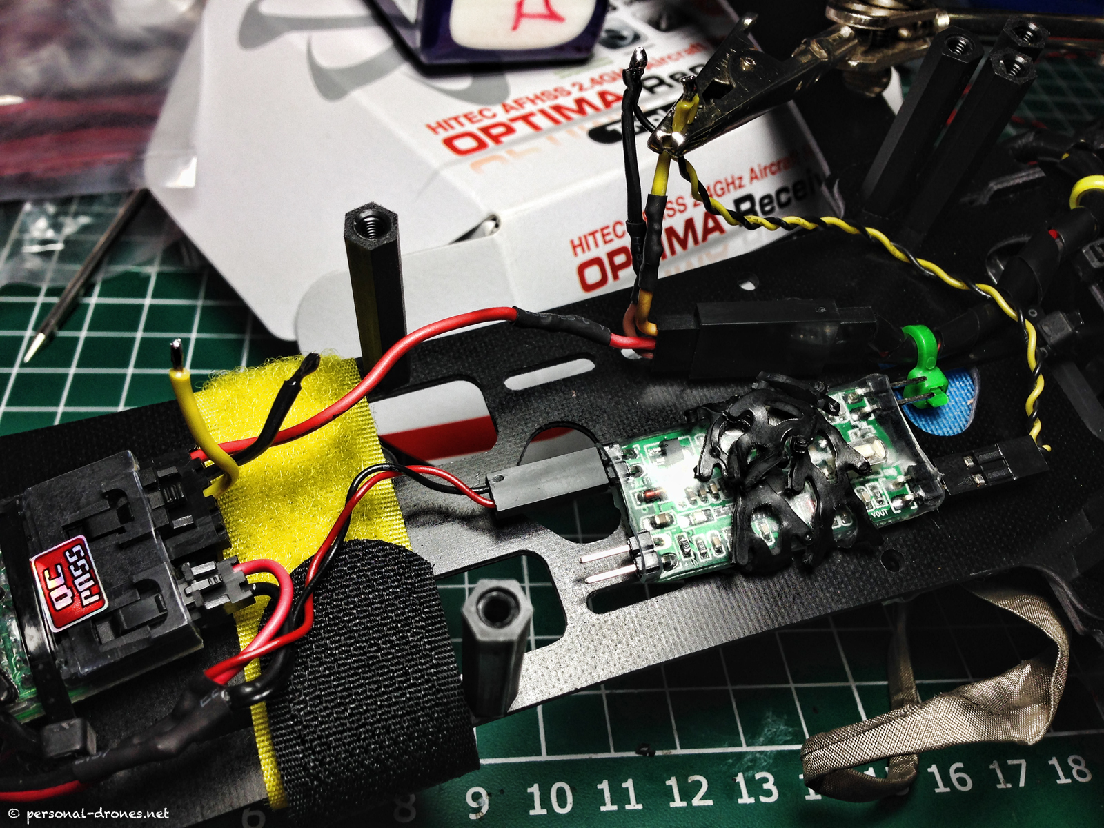 Wiring the Mini OSD into the FPV system of the FlyXcopter