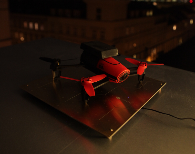 Parrot's Beebop drone charging on a Skysense pad